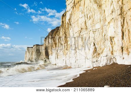 View of chalk cliffs between Seaford and Newhaven, near Tide Mills, East Sussex, Enlgand in a high tide, selective focus