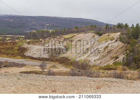 A beautiful sand dune in the middle of Norway. Northern desert in central Scandinavia in autumn. Colorful scenery that looks like a barren land. poster