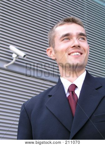 Businessman Outside A Modern Office Building