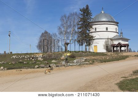 Morozovo village center with a view of the Church of the Intercession of the Holy Virgin in Verkhovazhsky district, Vologda region, Russia