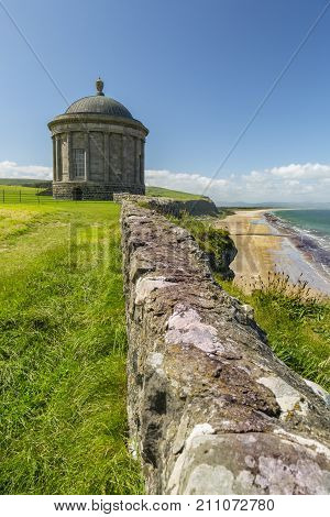 Northern Ireland - Aug 01 2017: Mussenden Temple a popular tourist attraction on the Atlantic Ocean coast of Northern Ireland.