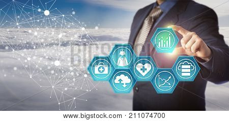 Unrecognizable database manager retrieving medical data in an electronic network. Business concept for management of health information technology and improvement of healthcare service efficiency.