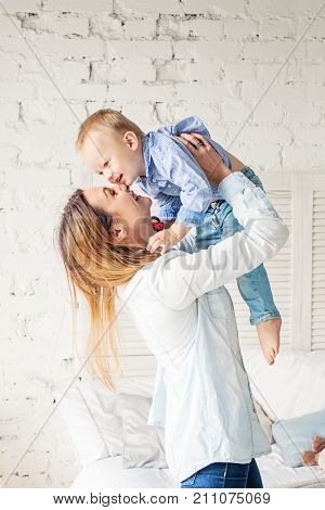 Happy Mother and Son at Home. Mother and Child Hugging. Happy Loving Family