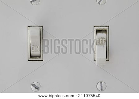 Two Light Switches with the left one on and the right off