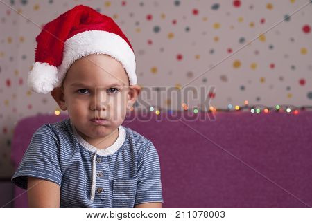 Angry Boy In A Santa Hat