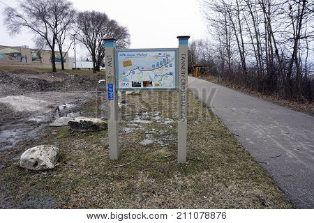 BAY VIEW, MICHIGAN / UNITED STATES - MARCH 30, 2017: A map, posted at the Tannery Creek Trailhead, provides information on public amenities available along the Little Traverse Wheelway, which connects, Charlevoix, Petoskey and Harbor Springs.
