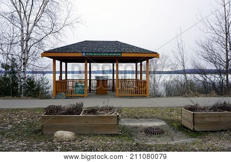 BAY VIEW, MICHIGAN / UNITED STATES - MARCH 30, 2017: One may enjoy the views of Little Traverse Bay from the Fettis-McCue Scenic Overlook, beside the Little Traverse Wheelway, which connects, Charlevoix, Petoskey and Harbor Springs.