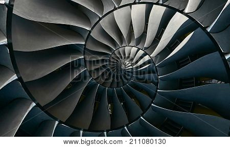 Turbine blades wings spiral effect abstract fractal pattern background. Spiral industrial production metallic turbine background. Turbine manufacturing technology abstract fractal pattern staircase