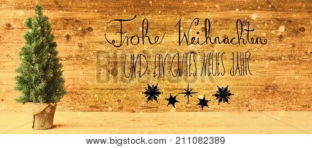 Calligraphy With German Text Frohe Weihnachten Und Ein Gutes Neues Jahr Means Merry Christmas And Happy New Year. Green Christmas Tree With Retro Brown Wooden Background And Snowflakes.