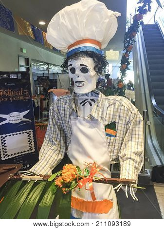 XALAPA, VERACRUZ, MEXICO- NOVEMBER 27, 2017: Skull dressed as a chef at a Day of the Dead festival in Xalapa, Veracruz, Mexico