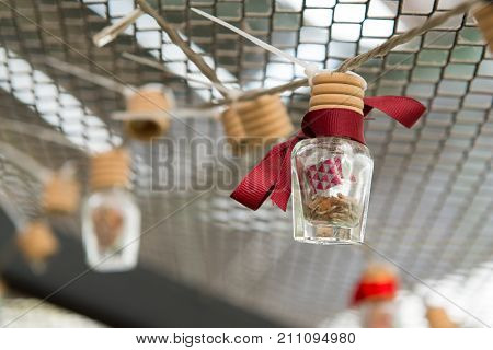 Wish message in a bottle with red color ribbon