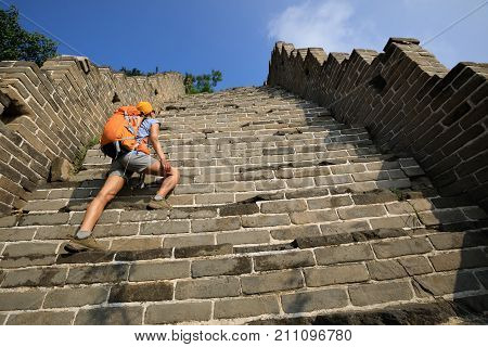 woman tourist climbing to the top of greatwall enjoy the view