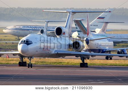 Domodedovo, Moscow Region, Russia - June 15, 2014: Kosmos airlines Tupolev Tu-154M standing at Domodedovo international airport.