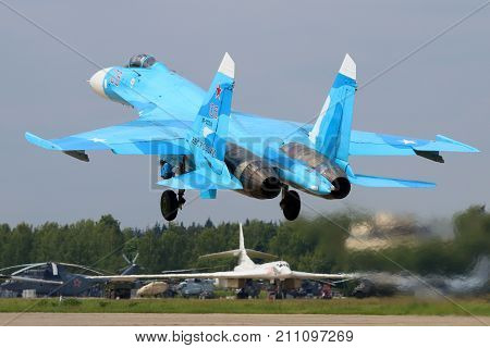 Kubinka, Moscow Region, Russia - June 20, 2015: Sukhoi Su-27SM RF-92210 jet fighter of russian air force takes off at Kubinka air force base.