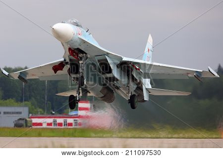 Kubinka, Moscow Region, Russia - June 20, 2015: Sukhoi Su-27SM RF-92209 jet fighter of russian air force takes off at Kubinka air force base.
