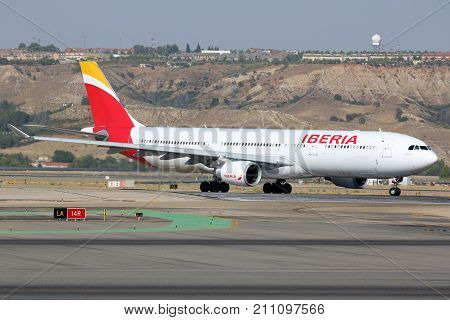 Madrid, Spain - August 12 2015: Airbus A330-200 in new livery of Iberia airline taxiing at Madrid Barajas Adolfo Suarez airport.
