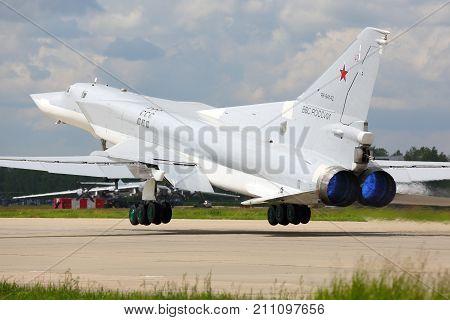 Kubinka, Moscow Region, Russia - June 22, 2015: Tupolev Tu-22M3 RF-94142 bomber of russian air force takes off at Kubinka air force base.