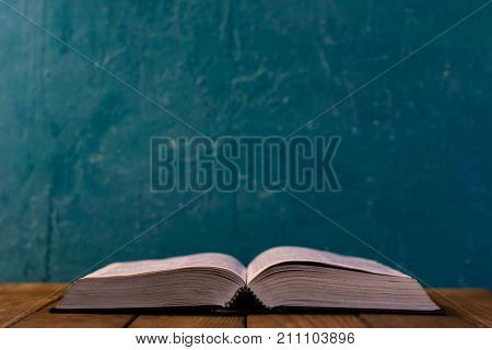 Bible on a brown wooden table. Beautiful background.Religion concept.