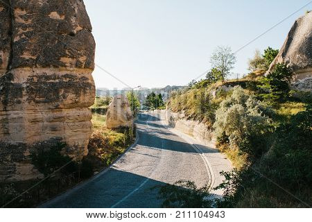 Beautiful view of the hills of Cappadocia. One of the sights of Turkey. Tourism, travel, nature. road near Goreme in Cappadocia