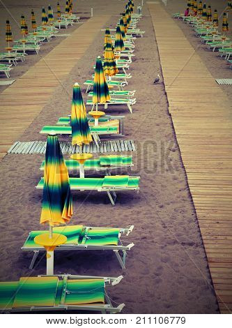 Beach With A Series Of Sunshades And Deckchairs  Wirh Vintage Ef