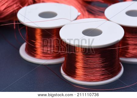 Copper electric coil and wire on metal background