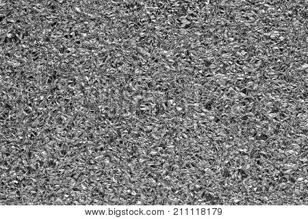 texture of a crumpled metal foil closeup for an abstract background or for festive wallpaper of silvery gray color