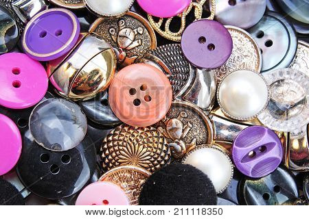 Buttons background. Colored shiny clothing button texture. Colored sewing buttons pattern concept wallpaper. Mixed colors. Studio photo texture photography. Buttons.