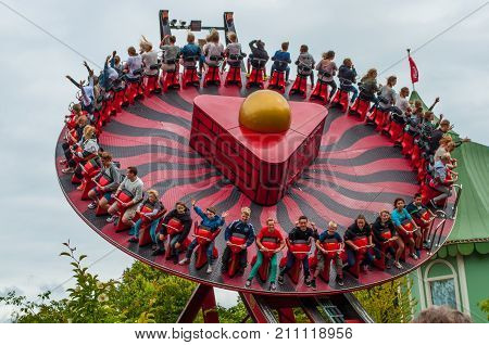 Gothenburg sweden - July 1. 2013: Young people having fun in Hanghai which is a swinging and spinning attraction in the Liseberg amusement park