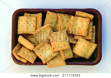 Square appetizer. Tray with cereal biscuits to take the appetizer.