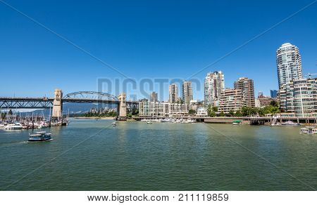 Vancouver Canada - June 23 2017: Burrard bridge and Marina with Vancouver's downtown in the background as seen from Granville island