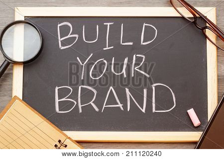 Build your brand concept with phrase BUILD YOUR BRAND written on chalkboard