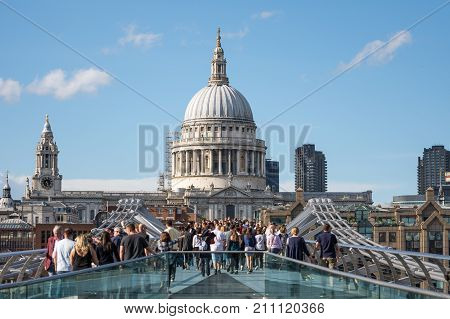 London UK - August 05 2017: St Paul's Cathedral with people walking on the Millenium bridge in the foreground