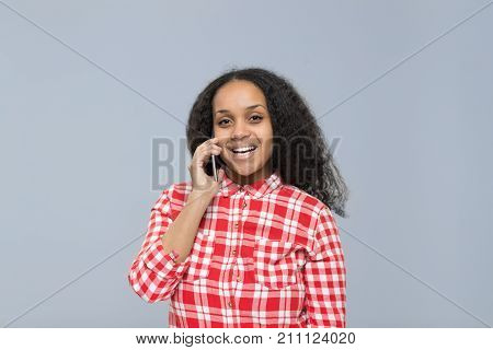 Young Woman Using Cell Smart Phone Talking Call African American Girl Happy Smile Chatting Online Isolated Over Gray Background