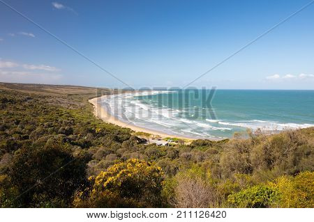 The famous Urquhart Bluff lookout on the Great Ocean Rd looking over Guvvos beach near Aireys Inlet in Victoria, Australia