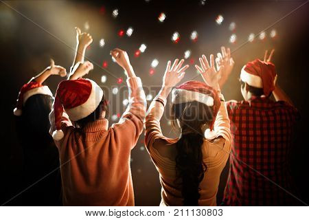 Christmas And New Year Party Celebration. People And Holiday Concept. Dancing And Celebrate Theme