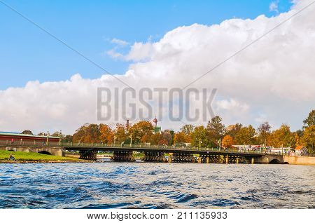 ST PETERSBURG RUSSIA - OCTOBER 3 2016. Ioannovsky bridge leading to the Peter and Paul fortress in St Petersburg Russia. Architecture landscape of St Petersburg Russia landmark