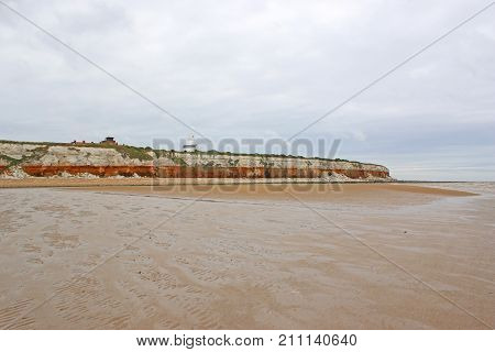 Lighthouse on the cliff above Old Hunstanton Beach