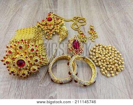 Thai wedding rings Necklace bracelet belt on traditional Thai style garland.engagement ring in Thai wedding ceremony in an open box on traditional Thai style garland.engagement ring in Thai wedding ceremony