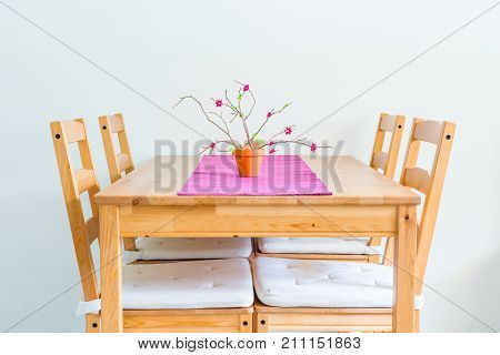 Minimalistic dinning table. Homely design of wooden furniture.