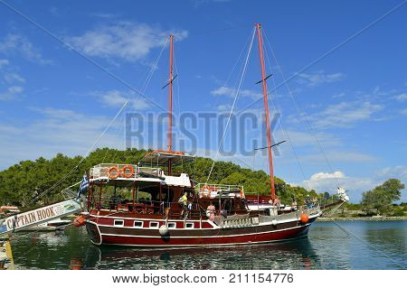 Antipaxos Greece - October 01 2017 : Captain Hook pirate tourist ship in Antipaxos harbour ready to sail to Corfu