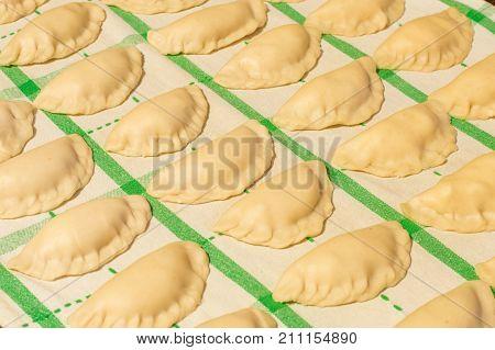 Raw dumplings with onion, quark and potato knows in Poland as Russian dumplings (Polish: Pierogi ruskie).