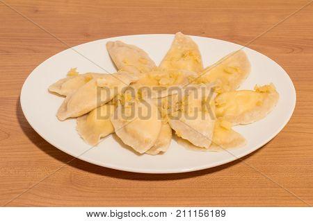 Dumplings with onion, quark and potato knows in Poland as Russian dumplings (Polish: Pierogi ruskie).