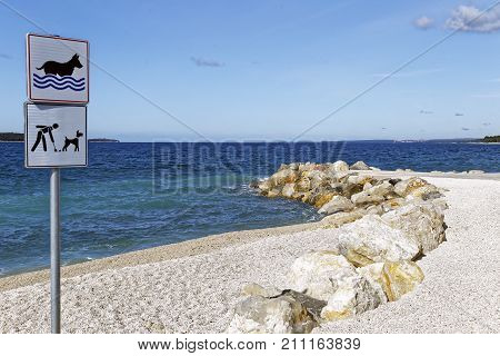 dog friendly beach and pick up after your dog signs