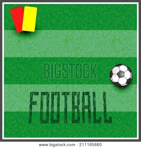 banner with the name football from the grass for the field. there is a ball and penalty cards.