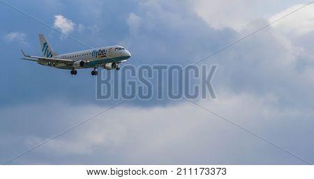 BIRMINGHAM INTERNATIONAL AIRPORT, BIRMINGHAM, ENGLAND - OCTOBER 28, 2017: a Flybe Airlines aeroplane landing in Birmingham International Airport.