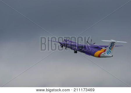 BIRMINGHAM INTERNATIONAL AIRPORT, BIRMINGHAM, ENGLAND - OCTOBER 28, 2017: a Flybe Airlines aeroplane taking off in Birmingham International Airport.