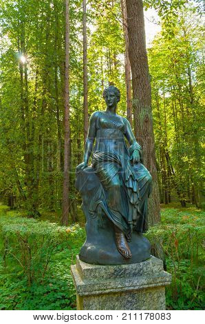 PAVLOVSK ST PETERSBURG RUSSIA - SEPTEMBER 21 2017. Bronze sculpture of Euterpe - the muse of music and eloquence. Old Silvia park in Pavlovsk St Petersburg Russia