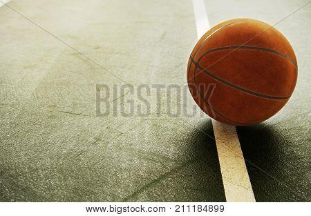 brown orange old vintage basketball on indoor gymnasium indoor sport green floor with white line background poster