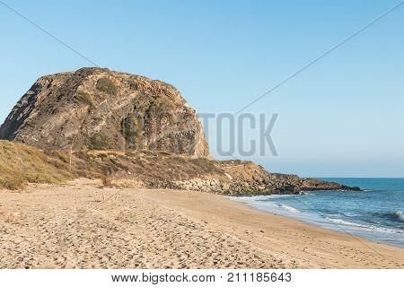 Mugu Rock on the Pacific Coast Highway at Mugu State Park in Malibu, California.