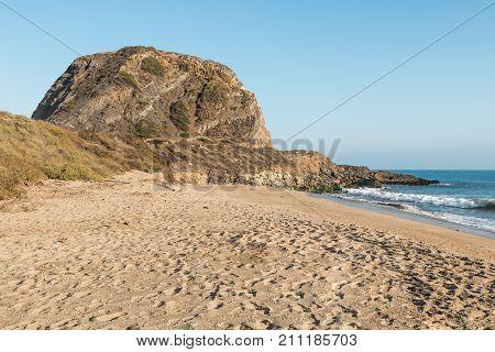 Mugu Rock at Point Mugu State Park on the Pacific Coast Highway in Malibu, California.